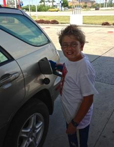 Josiah filling the tank